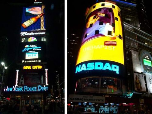 [Photo of Times Square advertisements]