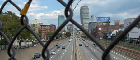 Photo: Boston highway, seen from behind chain link fence