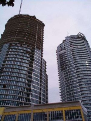 Photo of round condo towers under construction